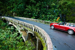 "Maui ""The Magic Isle"" - Convertible going over a bridge on the road to Hana"
