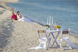 Virtual Honeymoon - Couple resting on the beach